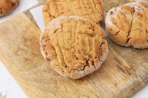 sugary peanut butter cookies on a cutting board