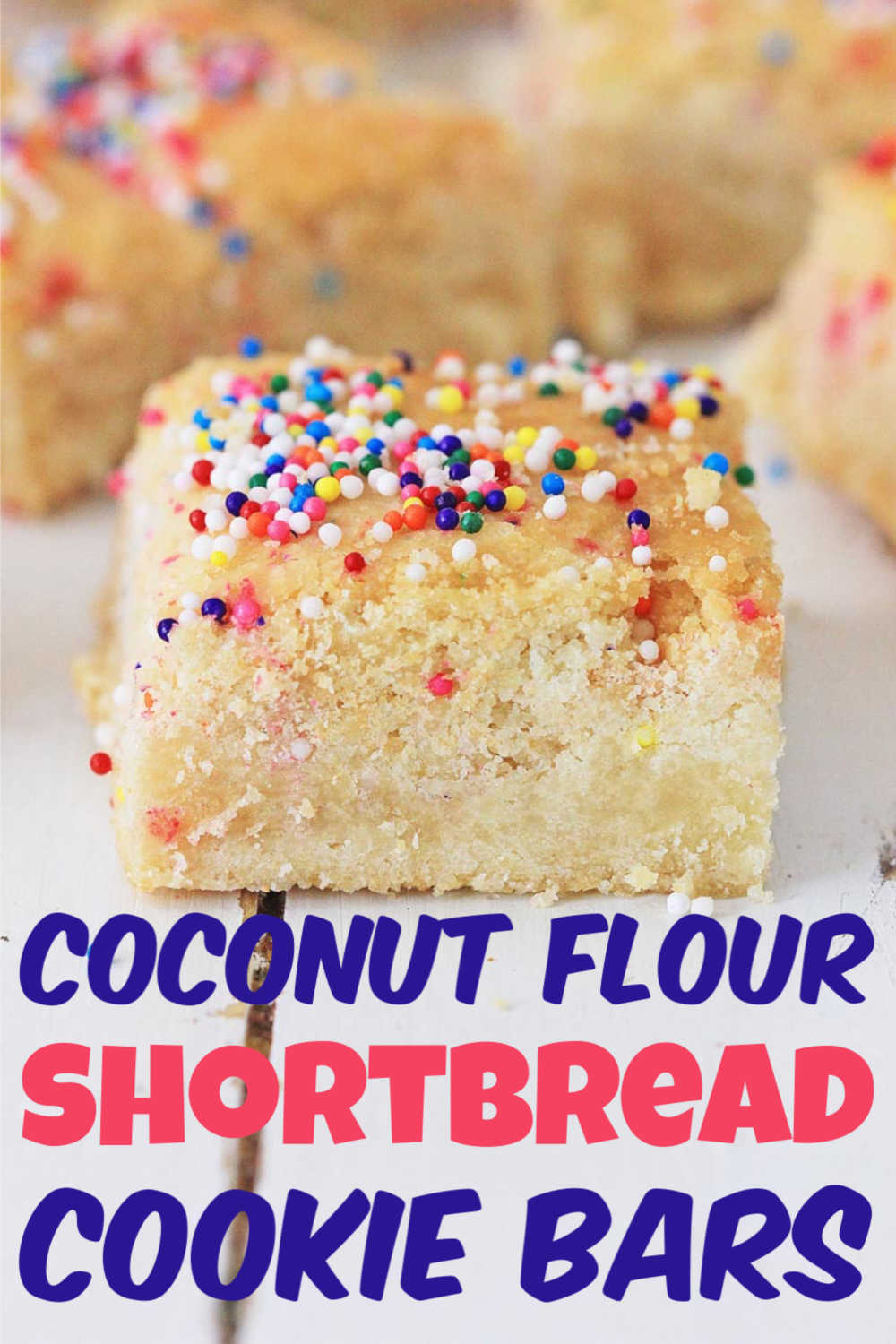 Coconut Flour Shortbread Cookie Bars are gluten free and DELISH! These are easy to whip up and will knock the socks off your guests. Sprinkle the top with candies to brighten up this classic recipe! #shortbread #shortbreadcookies #glutenfree