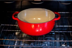 preheat a dutch oven to help seal the crust of bread when the dough is added