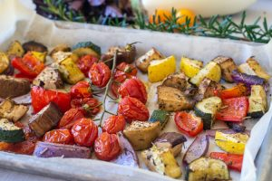 Sheet pan with roasted veggies after cooking in the oven