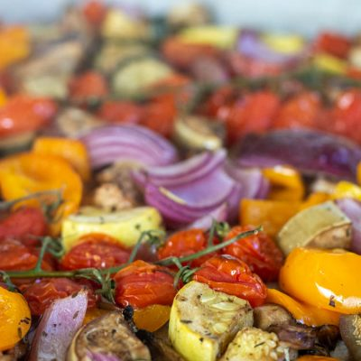 Front view of a sheet pan with roasted mediterranean vegetables