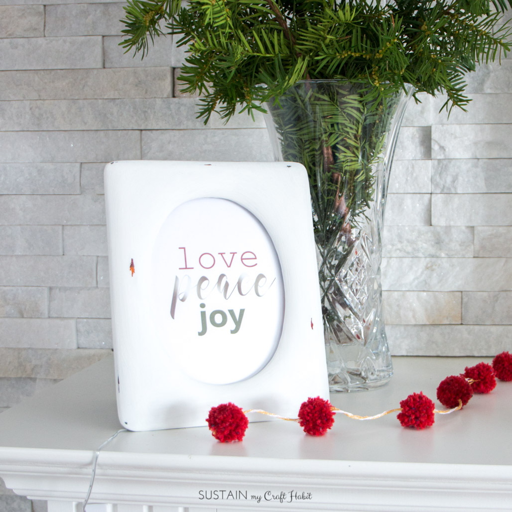 Peace Love Joy printable in a frame on the mantel
