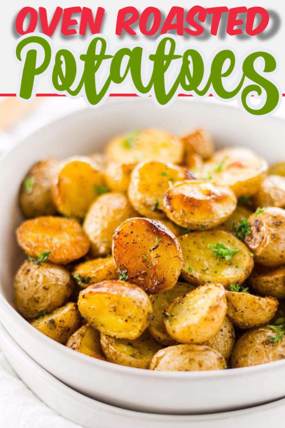 This crispy oven roasted potatoes recipe is ready in under an hour, and is the perfect vegetarian side dish recipe. Whether it\'s a Christmas or Thanksgiving side dish or just something you\'re throwing together for an easy weeknight dinner. Honey Gold Potatoes are the best variety for roasting! You can\'t beat these delicious spuds! #honeygold #ovenroasted #potatoes