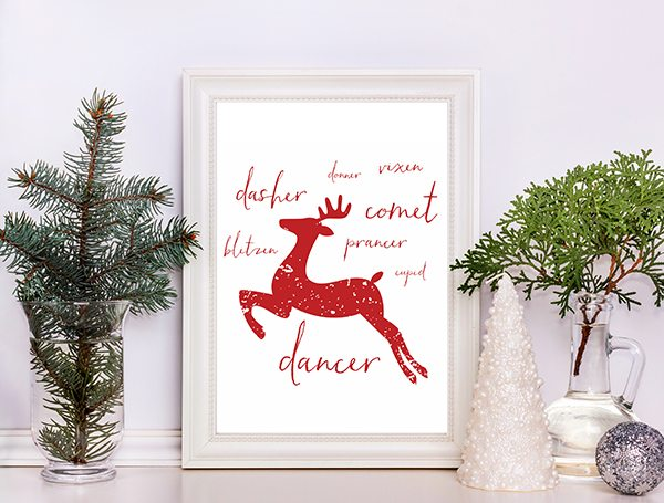 Reindeer Silhouette with the names of the famous reindeers in a wooden picture frame.