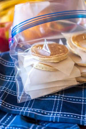 freezer ziplock bag filled with stacks of pancakes separated by parchment paper