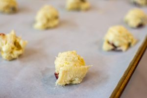 cake mix cookie dough scooped on a sheet pan and ready for the oven