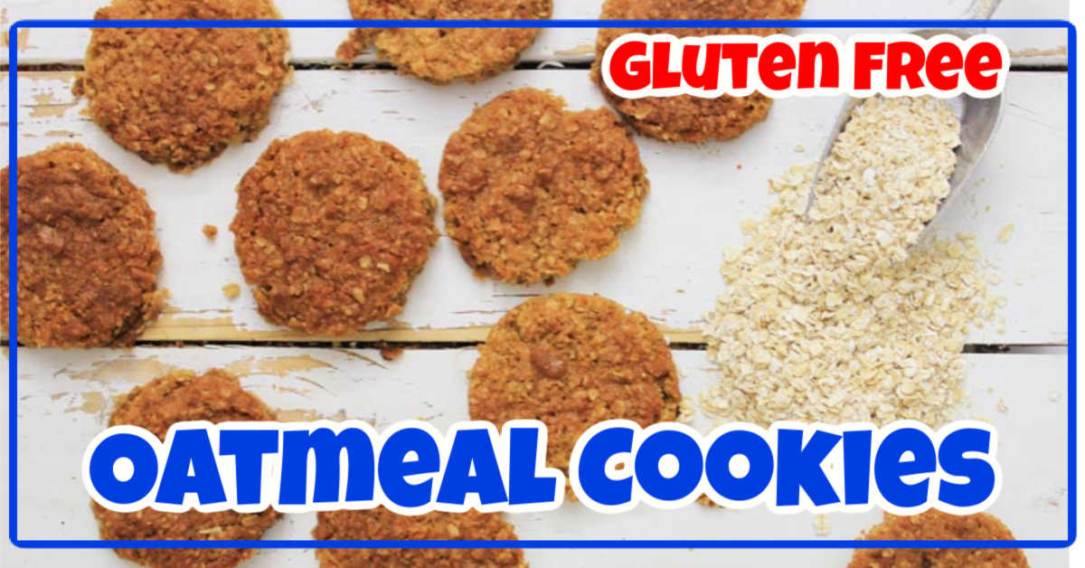 Gluten free oatmeal cookies on a white board with a scoop of loose oatmeal spilling out