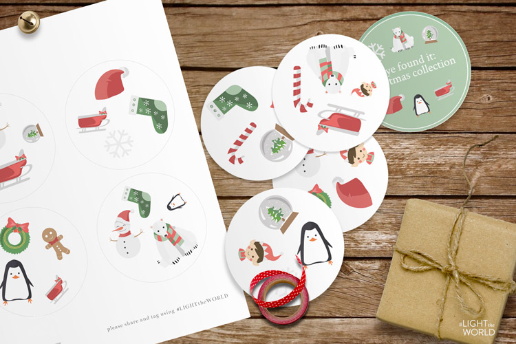 Collection of cute holiday Printables cut into circular stickers on a wooden table.
