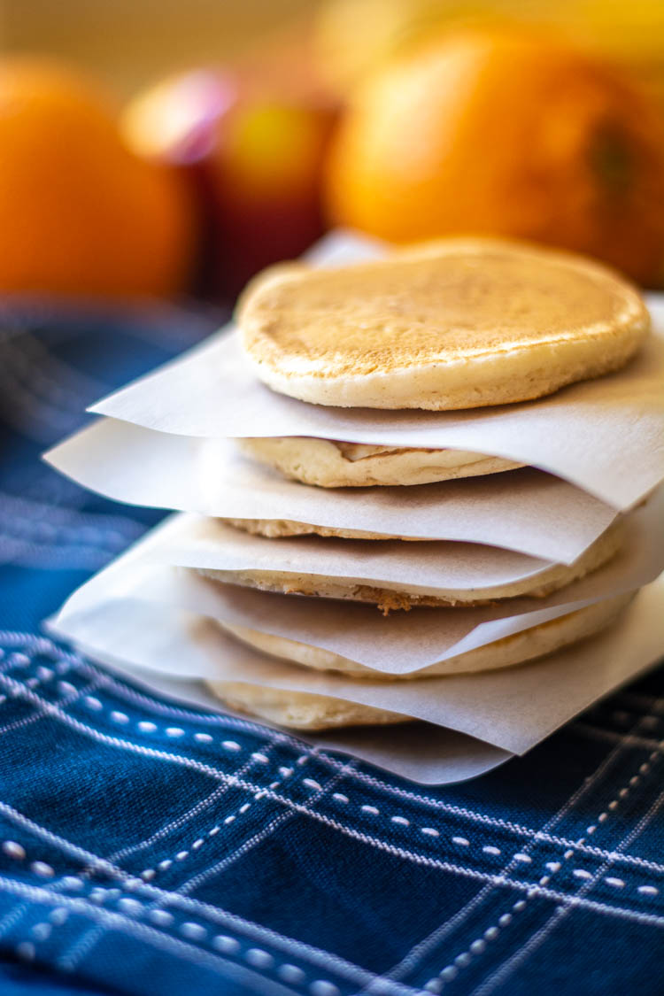 stack of pancakes separated by parchment paper