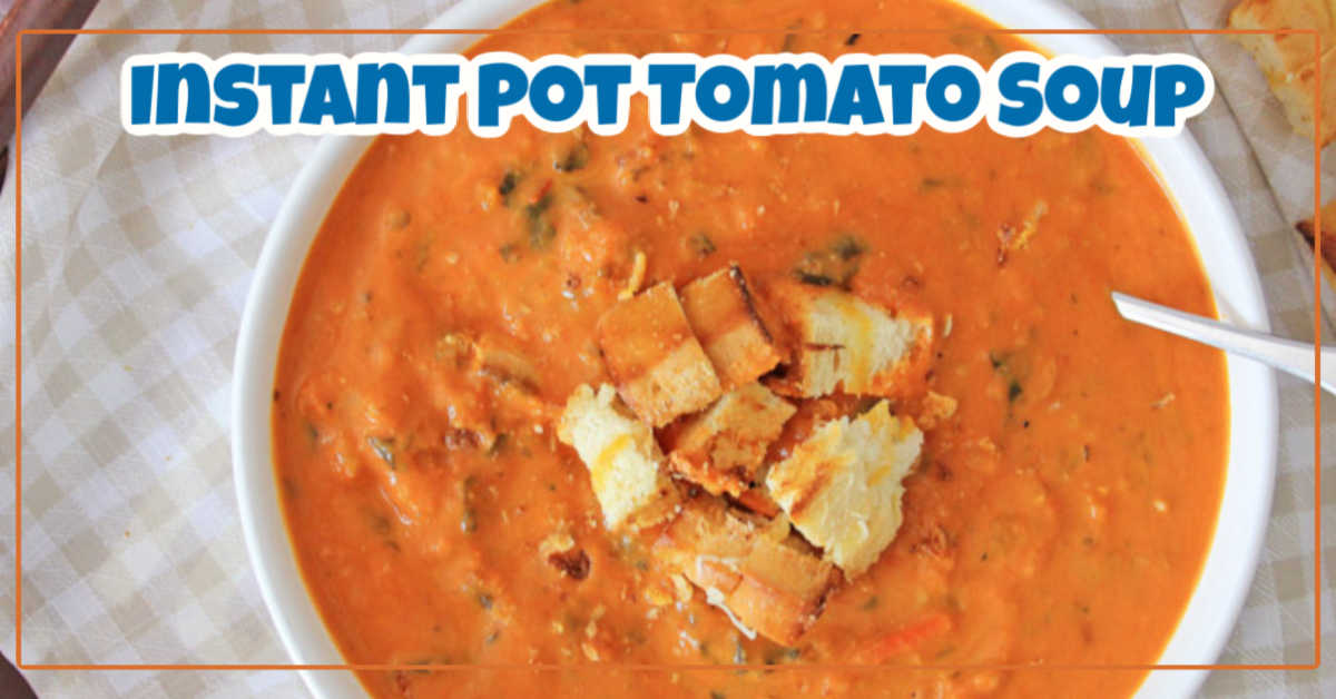 Top Down picture of bowl of instant pot tomato soup in a white bowl with croutons on top
