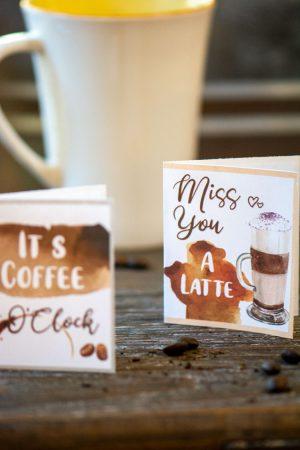 Small coffee notecards on a cutting board