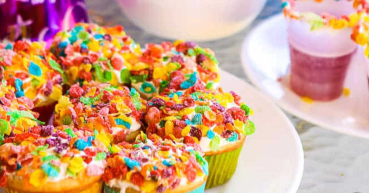 Fruity Pebbles as confetti on top of cupcakes