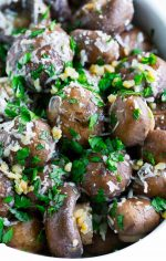 bowl of roasted mushrooms mixed with garlic and parsley