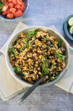Cauliflower Rice with Black Beans and Kale in a dish