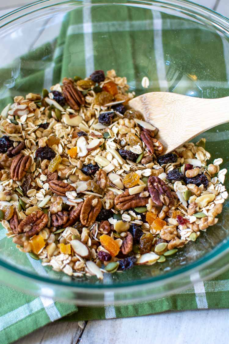 all of the muesli ingredients in a glass bowl and stirred with a wooden spoon.