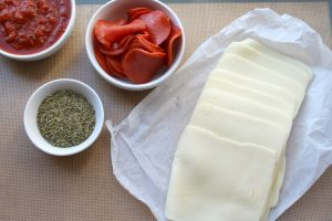 the ingredients for the easy pizza rolls and the optional dipping sauce