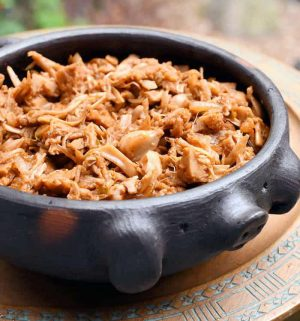 Rustic bowl filled with a chili jackfruit that was made in the instant pot