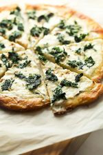 Whole sliced florentine pizza with a low carb crust