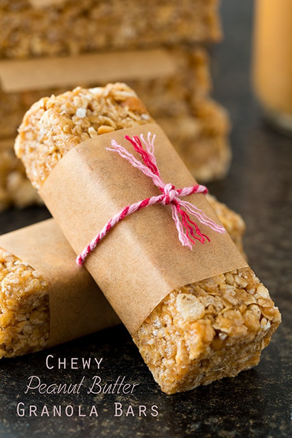 Bar of peanut butter granola wrapped in paper and tied with the string