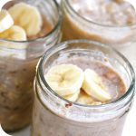 three jars of refrigerator oatmeal with banana slices on top