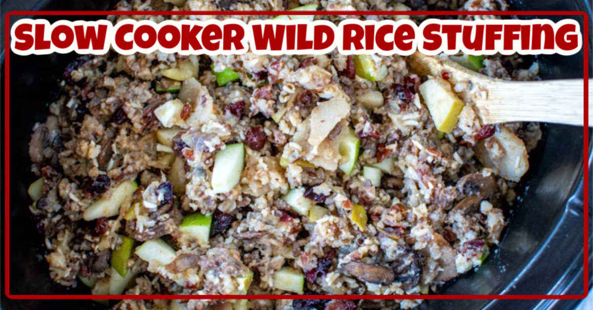top down view of cooked wild rice in the slow cooker with a text overlay