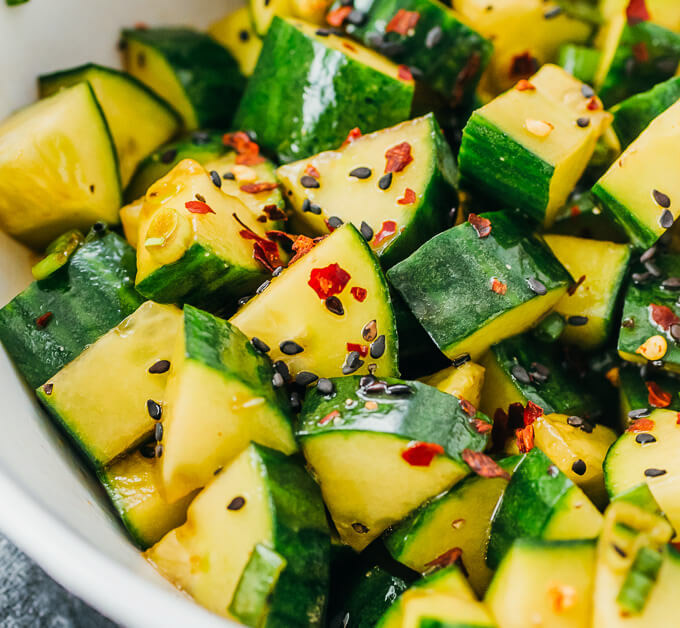 Cucumber Salad with spicy pepper flakes in a white bowl