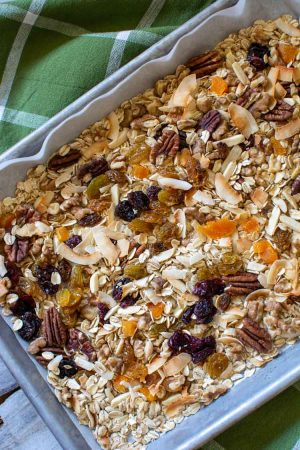 sheet pan with oats, coconut and other mixings for muesli