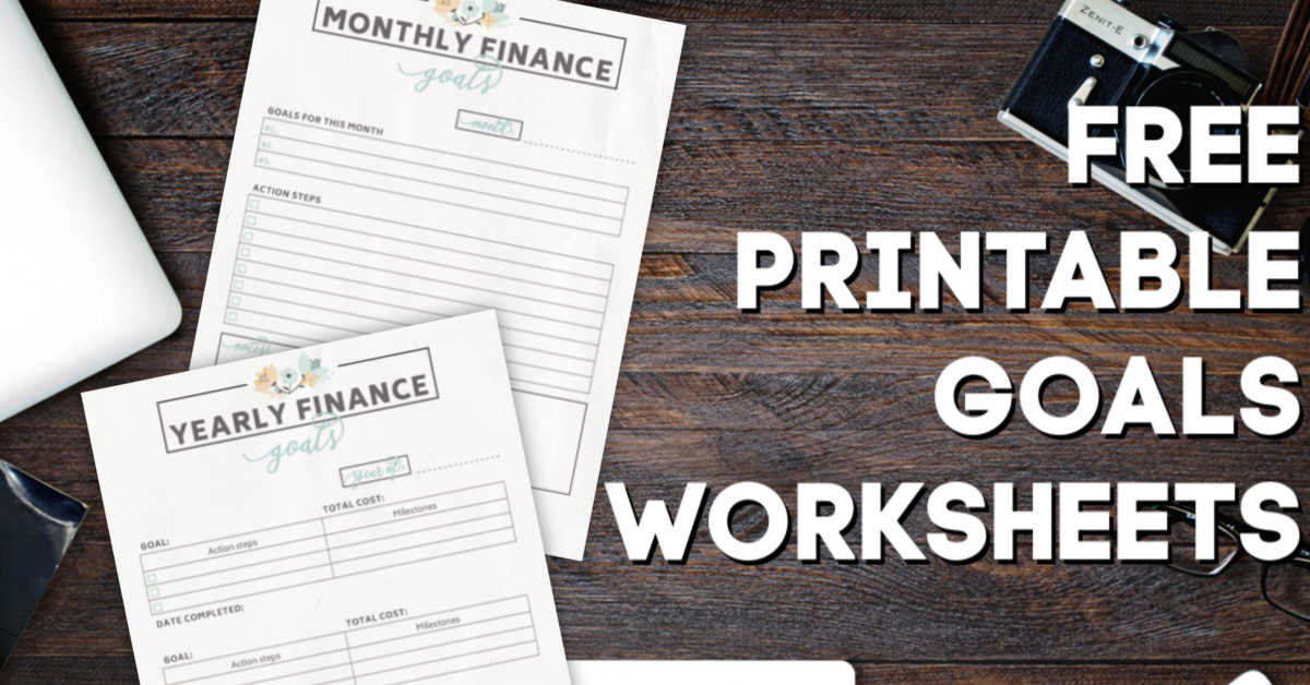 two printable goal worksheets on a wooden desktop