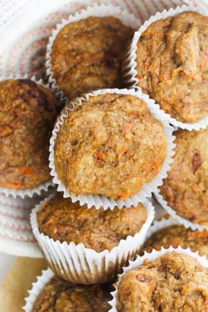 several stacked muffins with hints of carrot slices