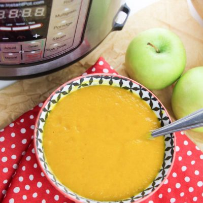 Bowl of squash soup with two apples and the instant pot