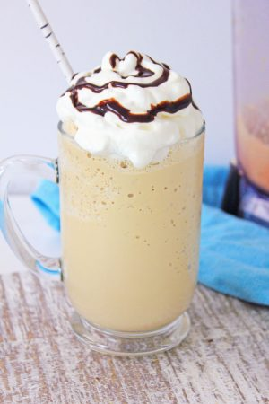 frappe topped with whipped cream and chocolate sauce swirl