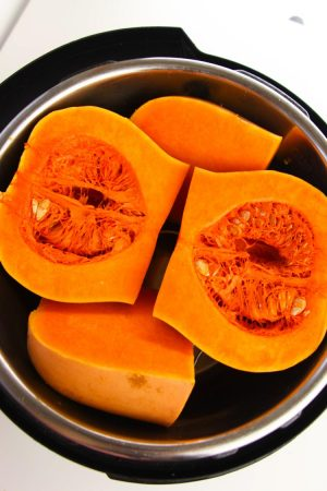 inside the instant pot with quartered butternut squash to cook