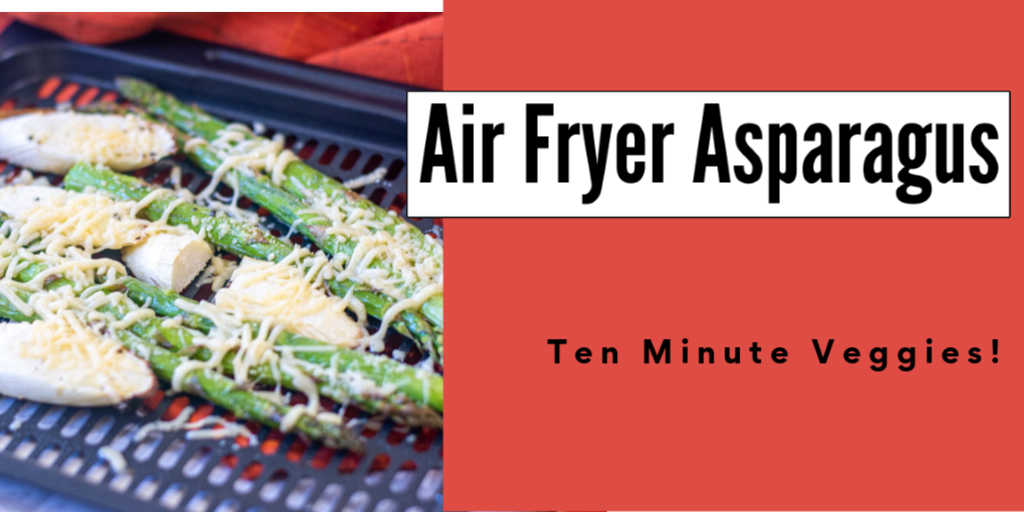 tray of cheesy air fryer asparagus with text box for this 10 minute vegetarian dish