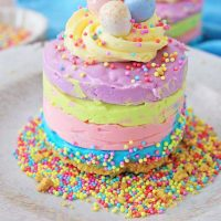 spring colors of layered no bake cheesecake topped with cadbury eggs