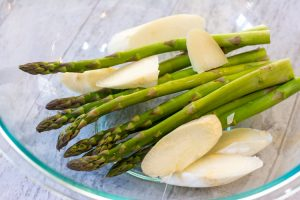 glass bowl with white and green asparagus