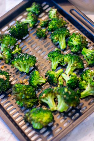 closeup of the roasted broccoli with garlic added