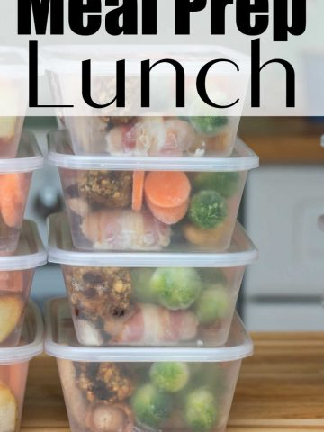 stacked meal prep containers filled with fresh food