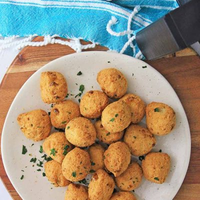 pile of air fried hush puppies on a plate