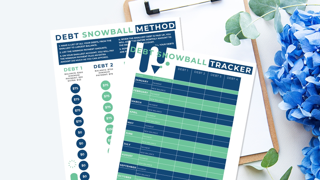 snowball debt printable pages stacked on a clipboard