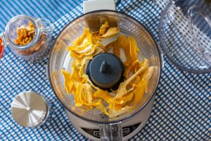 dried and crispy lemon peels in a small food processor