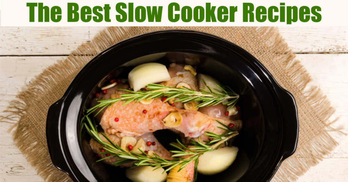 slow cooker filled with chicken, onions, rosemary on a nice wooden table