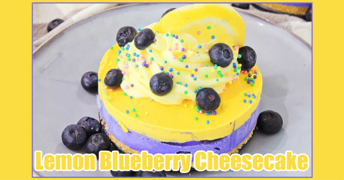 gorgeous yellow and purple no bake lemon blueberry cheesecake decorated with a lemon slice and bleuberries