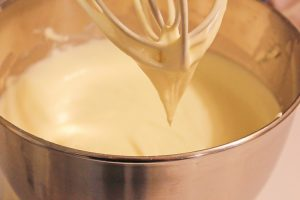 mixing the cheesecake batter in a stand mixer.