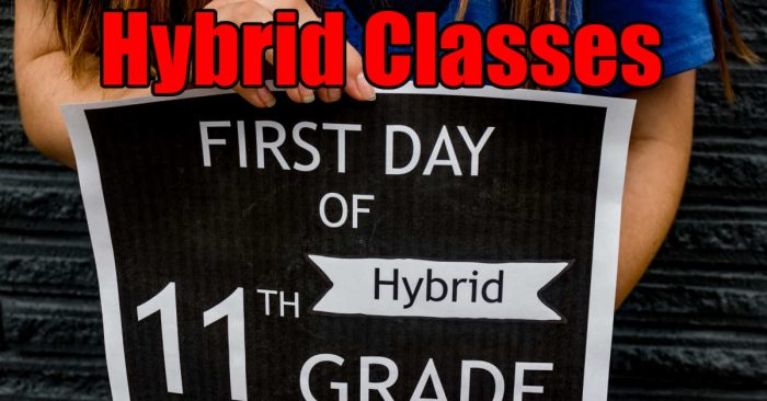 girl holding a hybrid classes sign