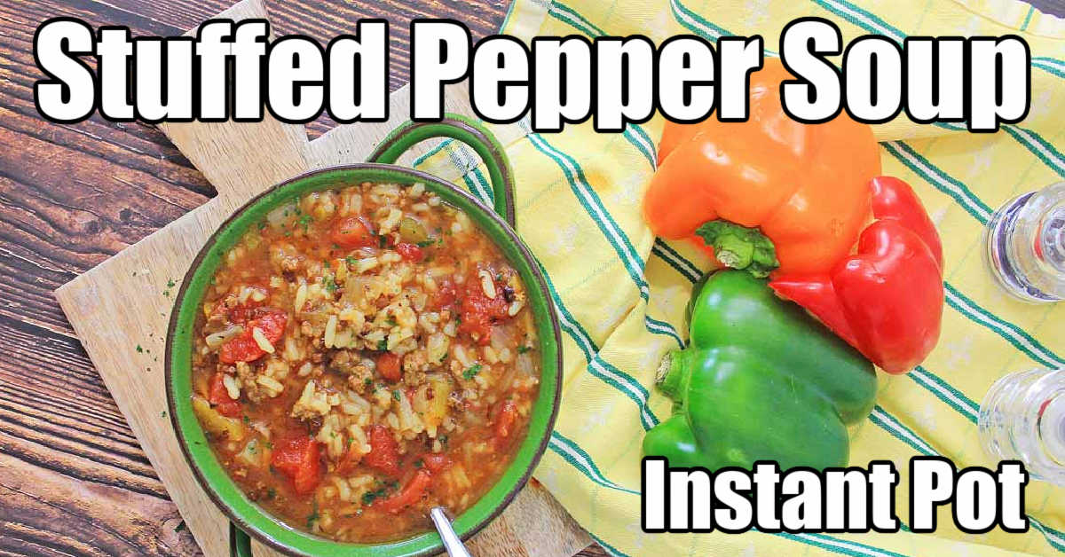 top down view of a bowl of stuffed pepper soup in a green bowl with extra peppers on the side