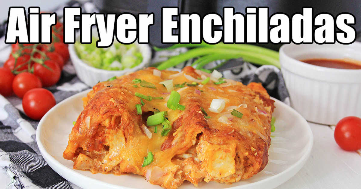 plate of toasty air fryer chicken enchiladas with sauce, tomatoes and onions in the background