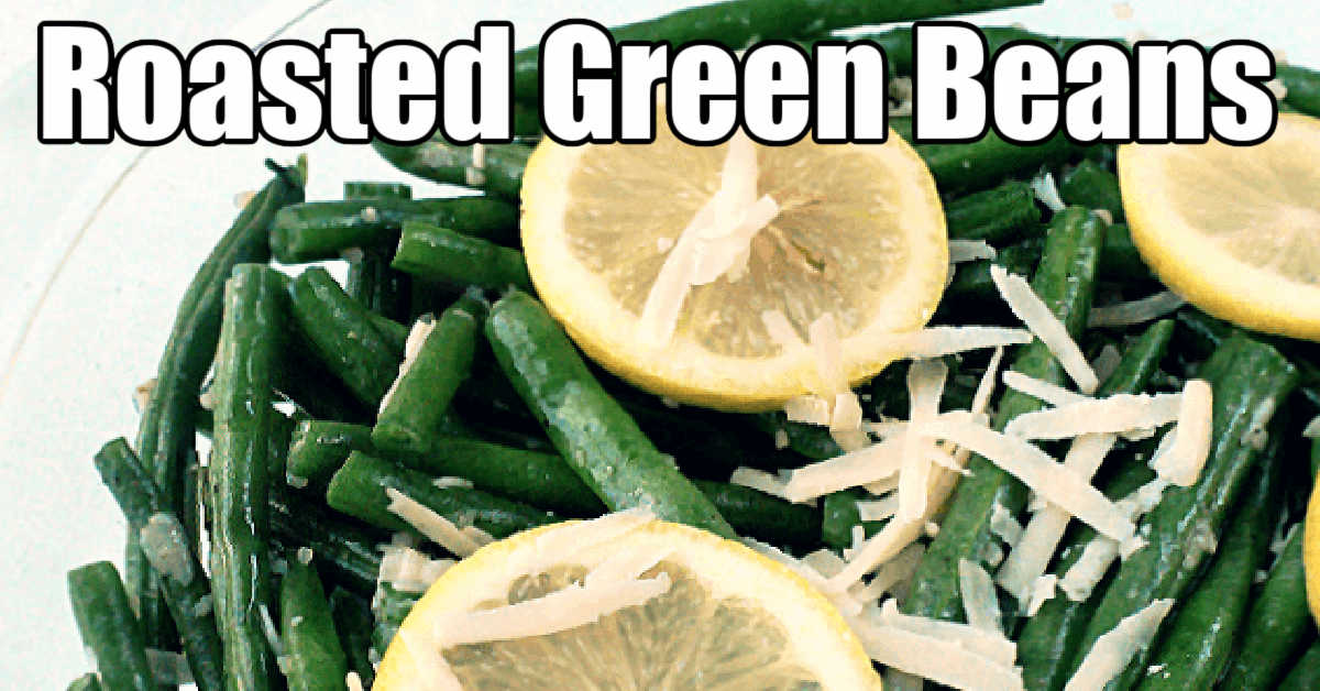 glass bowl with green beans, shredded parmesan and slices of lemons
