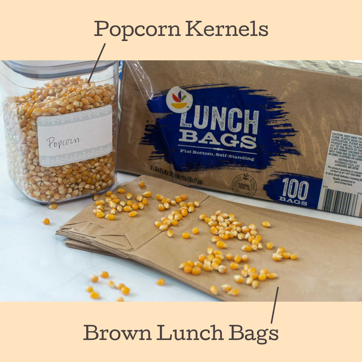 brown lunch bags and popcorn kernels on the table.