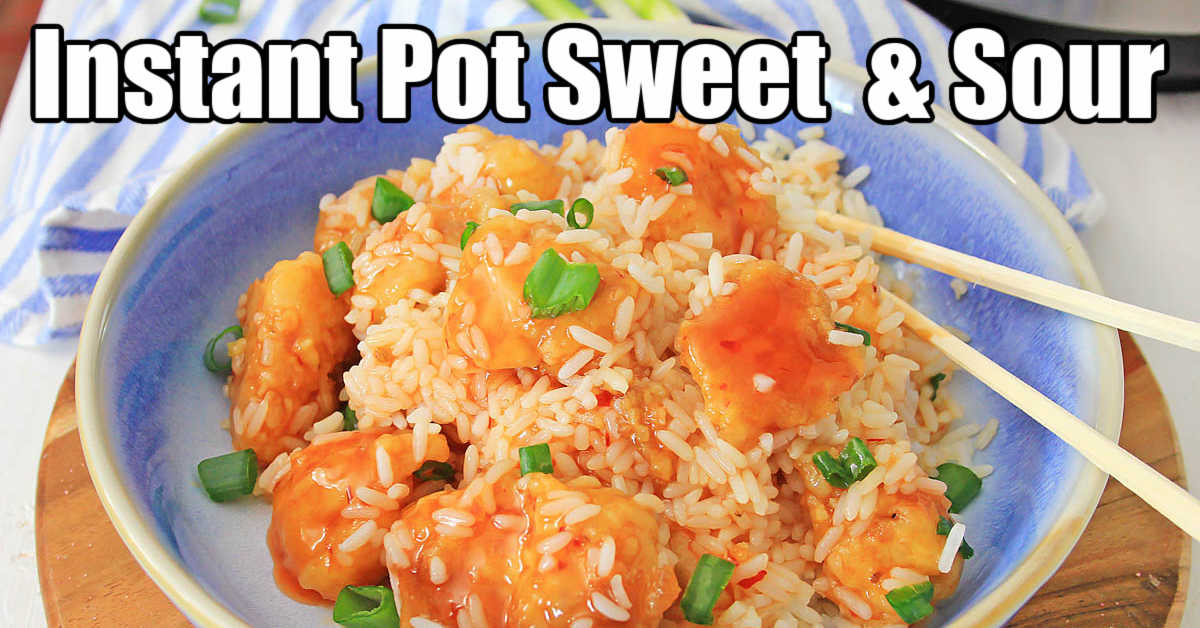 bow of sweet and sour chicken mixed in with rice an being eaten with chopsticks