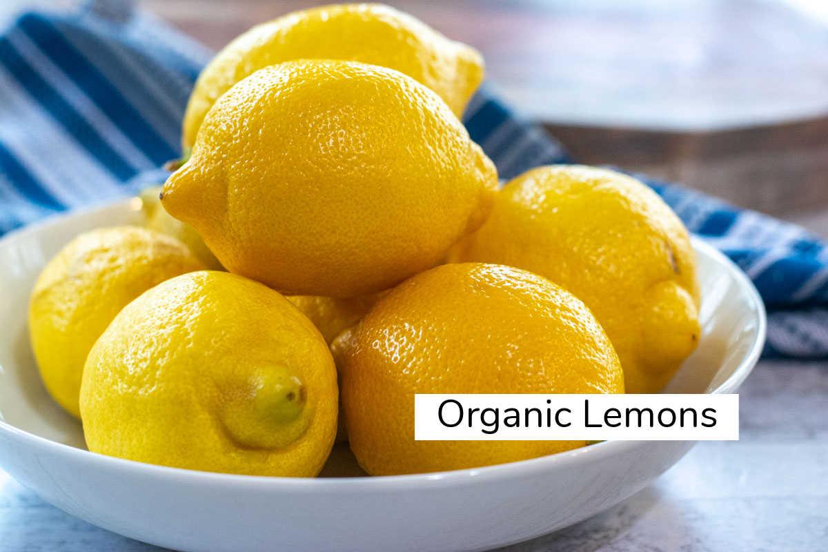 bowl of organic lemons labeled.